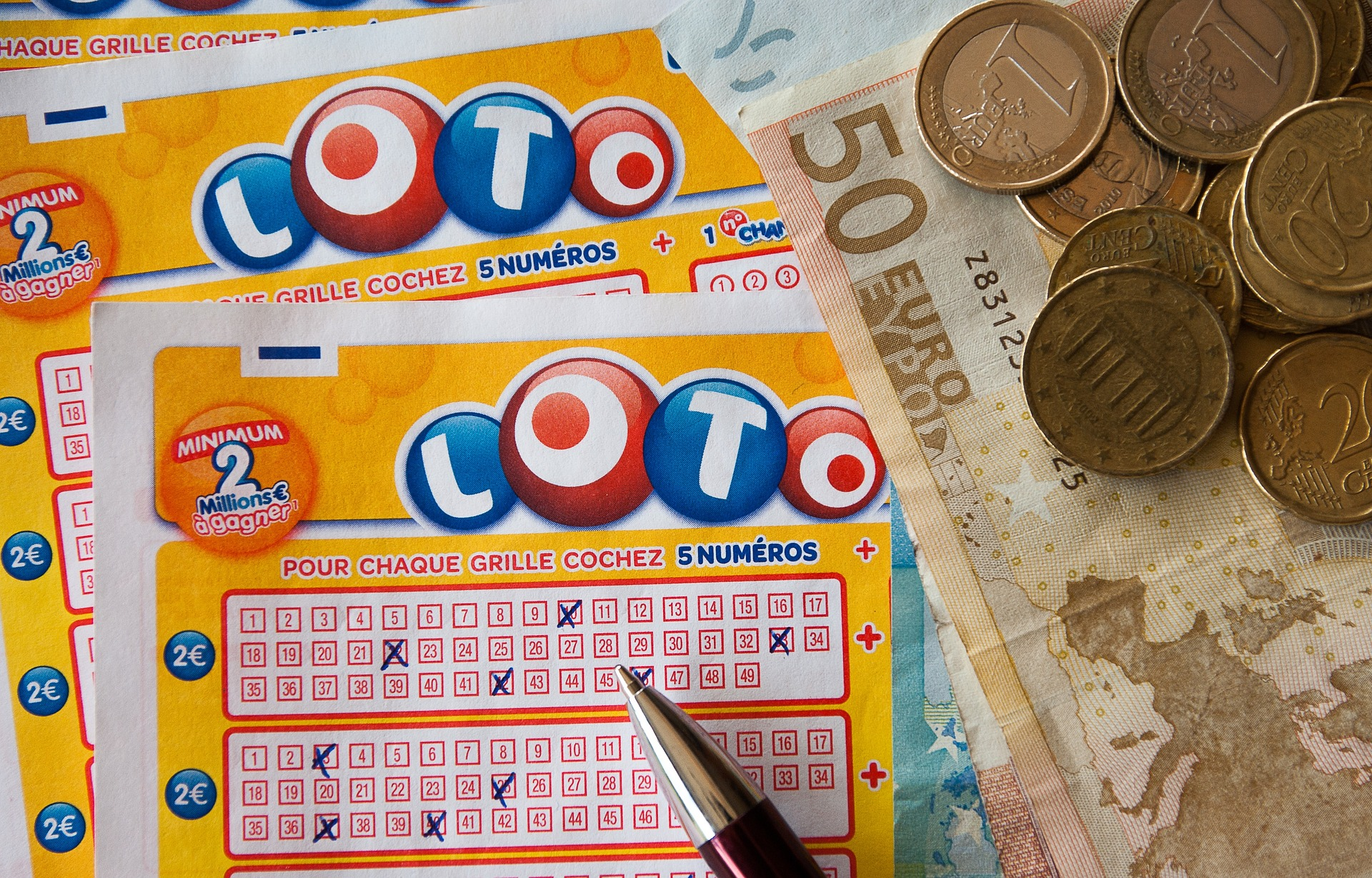 lottery tickets, pan and money on a table