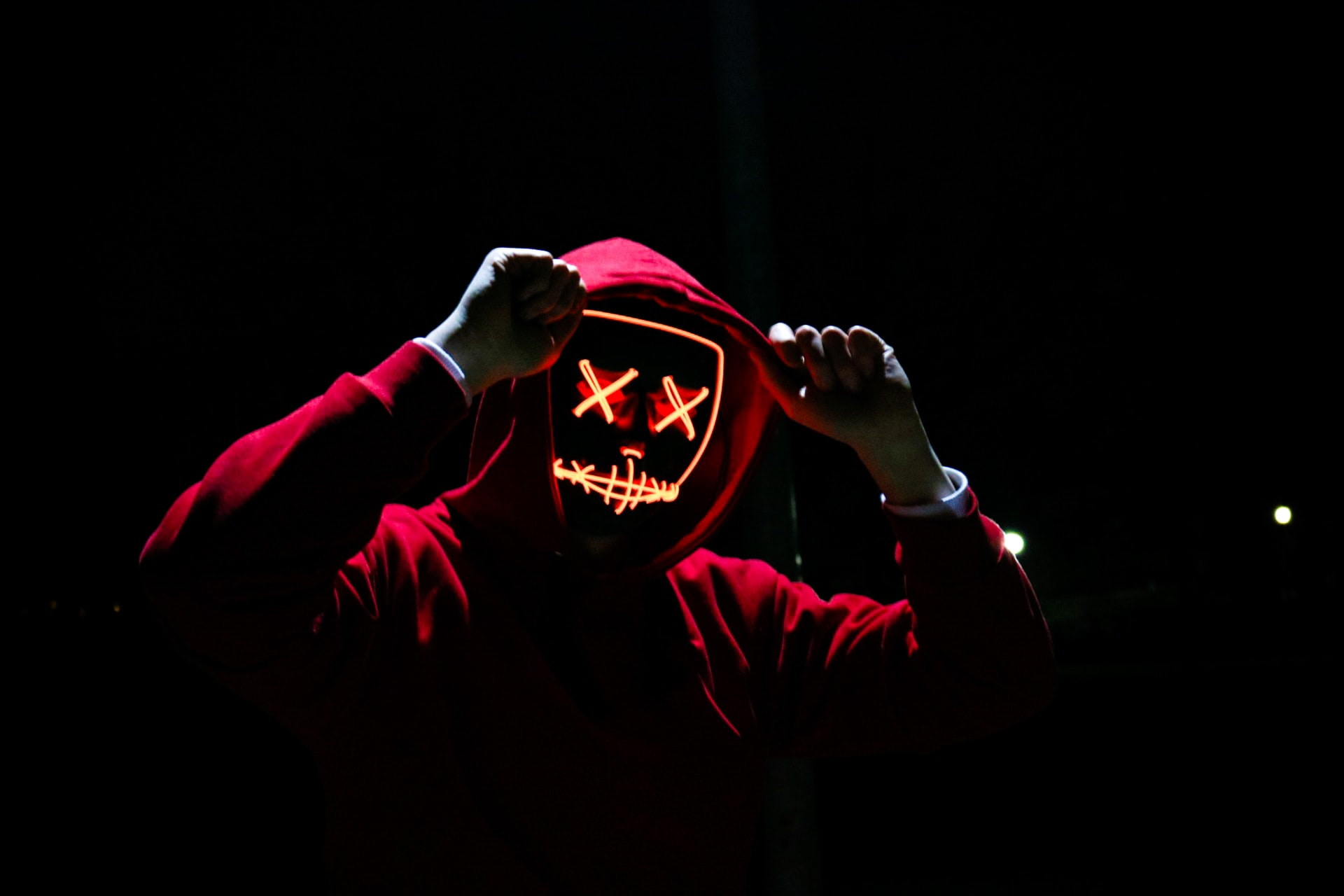 man in red hoodie and mask